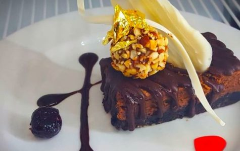 """A chocolate cheesecake with a brownie crust, garnished with a hazelnut truffle, white chocolate decorations and gold leaf. The thing I love most about this cheesecake is that not only does it have edible gold leaf, but it is also super easy to make and delicious"" says Avila."