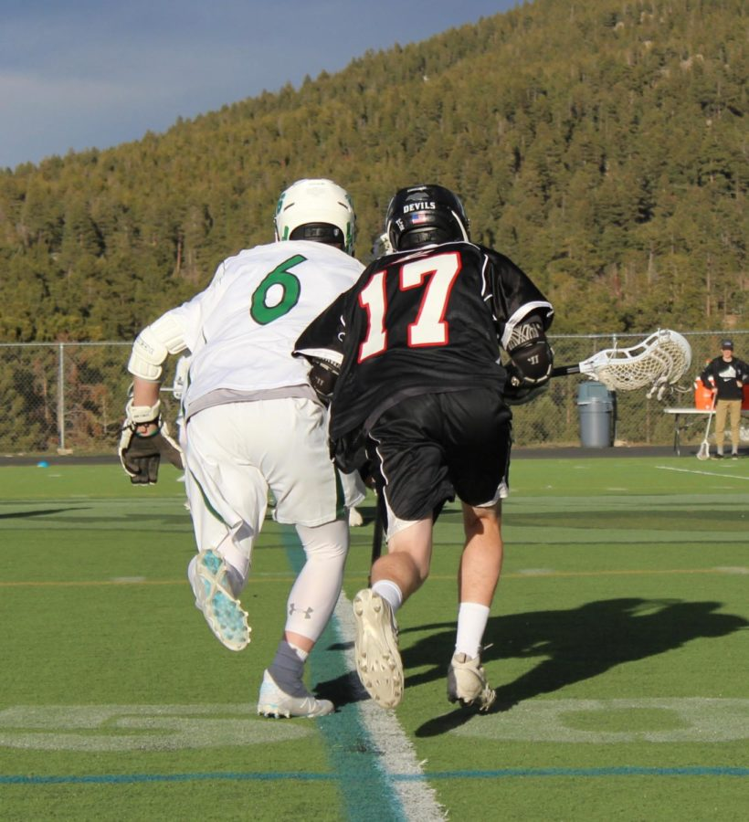 Joseph Hall '19 (#17) battles for a much needed ground ball for possession early in third quarter.