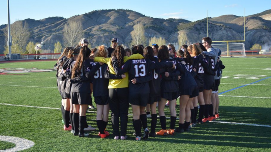 The+Eagle+Valley+Girls+Soccer+team+huddle+before+a+game+before+the+season+was+cancelled.+%0A%22I+miss+the+atmosphere+of+a+game+and+the+excitement+to+get+to+showcase+what+we+had+been+working+on+in+practice%2C%22+Coach+Maggie+Sherman+says+of+the+lost+soccer+season.+