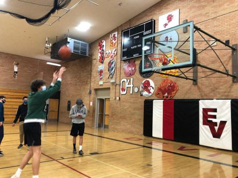 Students practice shooting at pre-season training for basketball.