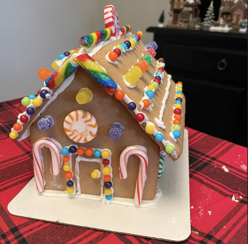 The Foster family's gingerbread house is fully detailed with gumdrops, candy canes, chocolate candies, and peppermint focal points.