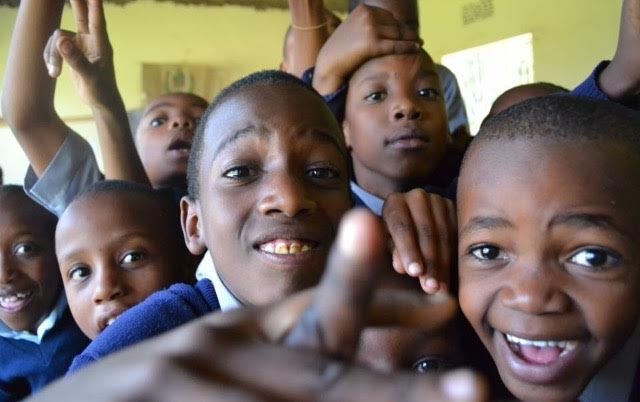 Students at L.O.A.M.O. primary school in Arusha, Tanzania excitedly jump at an opportunity to get their photo taken. Most of these children live poverty and hardly ever get to see modern technology.