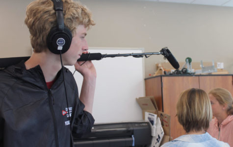 Tyler Morrison '21 collects dialogue audio using a boom mic.