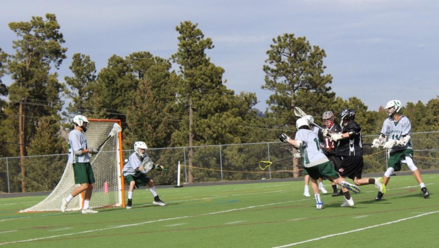 Alden Kostick '21 (#19) rips a shot in past Conifer to tie up the score to 2-2 in the first quarter.