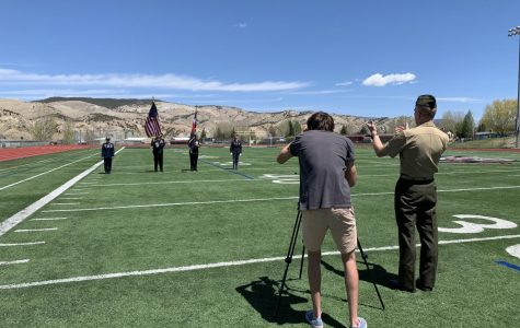 Nate Felton '17 maintains social distance as he records video of the Minturn VFW performing the Presentation of Colors for the virtual graduation ceremony at Eagle Valley High School.