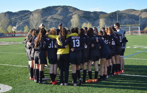 The Eagle Valley Girls Soccer team huddle before a game before the season was cancelled.