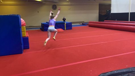 August Stovall going for her tumbling pass at practice.