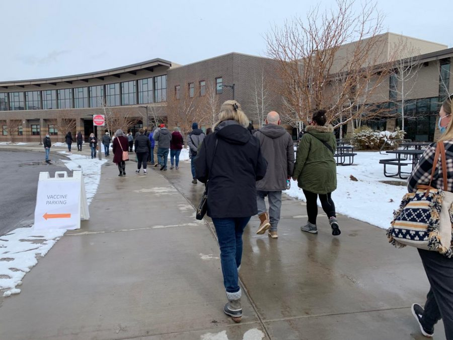 Eagle County residents wait in line outside of Battle Mountain High School to receive their vaccinations. Although the line was long outside, teachers reported that it moved quickly.