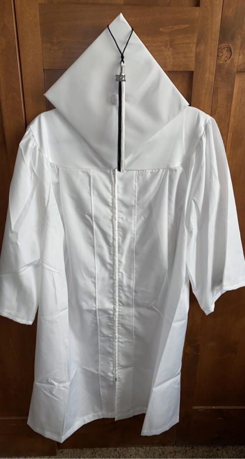 Students did not get to choose the color of their caps and gowns this year, but Katie Novak 21 is happy with the white gown she received.